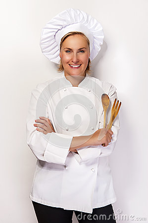 Free Young Woman Chef Holding Wooden Spoon And Fork. Stock Image - 60111551