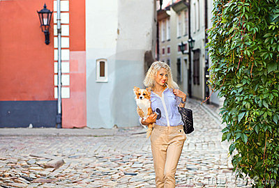 Young woman with chihuahua .