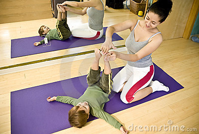 Young woman and child doing Pilates
