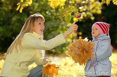 Young woman and child in park