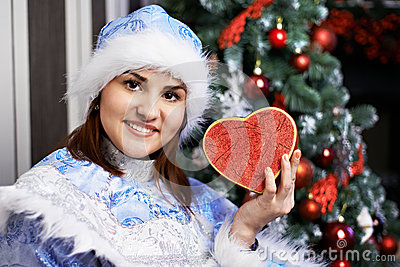 Young woman with Christmas costume with heart