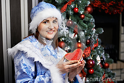 Young woman with Christmas costume Snow Maiden