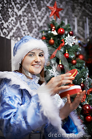 Young woman with Christmas costume Snow-Maiden