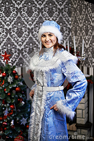 Young woman with a Christmas costume Snow Maiden