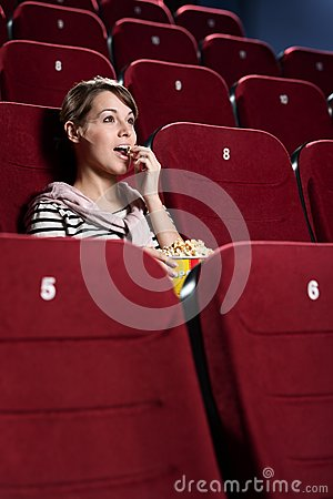 Young woman in the cinema hall