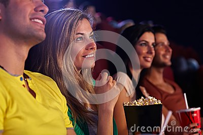 Young woman in cinema smiling