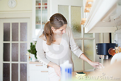 Young woman  cleaning the kitchen