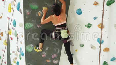 Young Woman Climbing A Rock Wall Indoors Stock Video Video Of Action Indonesia 100063053