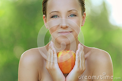 Young woman close up with big apple