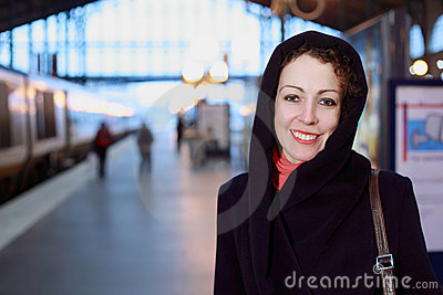Young woman close-up stands on railway platform Stock Photo