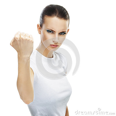 Young woman close-up threatens fist