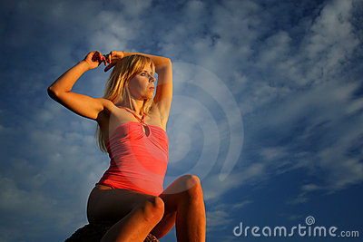 Young woman and cloudscape