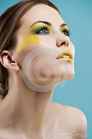 Young woman with colored glamour make-up