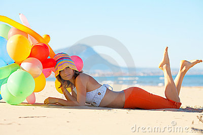 Young woman with colorful balloons