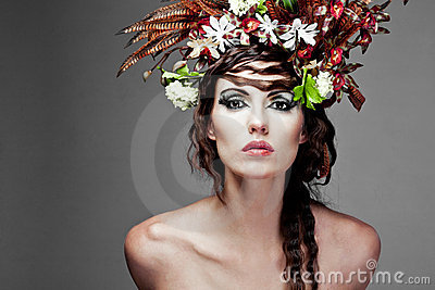 Young woman with colorful flowers in hair.