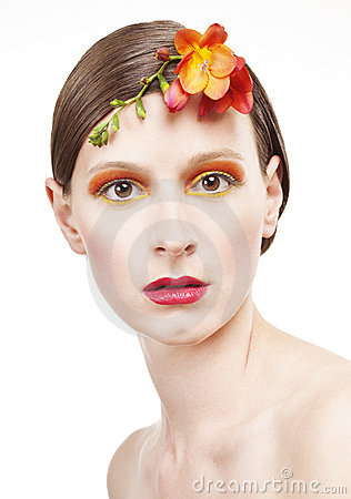 Young woman with colorful make-up and a flower
