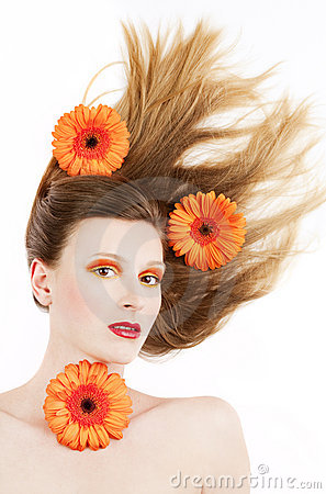 Young woman with colorful make-up and gerbera Stock Photo