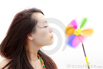 Young woman and colourful pinwheel