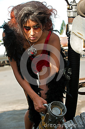 Young woman connecting a oil nozzle
