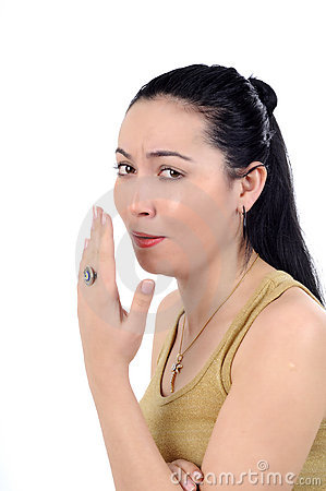 Young woman in coughing pose