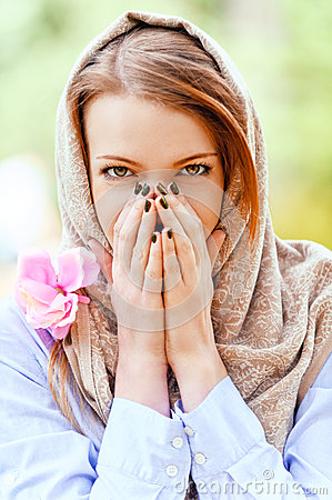 Young woman covered her hands