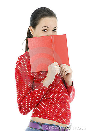 Young woman covering face by red book