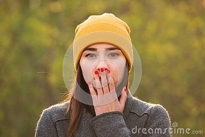 Young woman covering her mouth with her hand Stock Photo