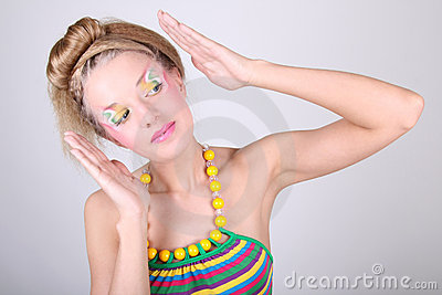 Young woman with creative make-up and coiffure