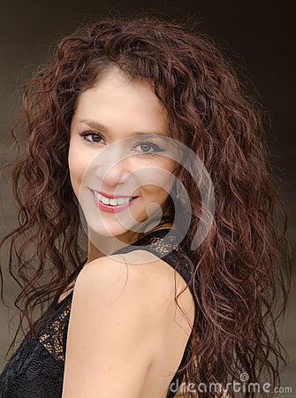 Young woman with curly dark hair