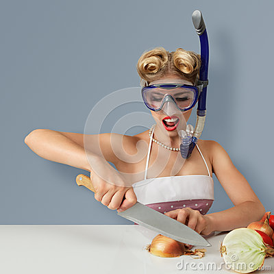 Free Young Woman Cutting Onion In Diving Mask Stock Photo - 26113750