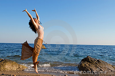 Young woman dance in the beach