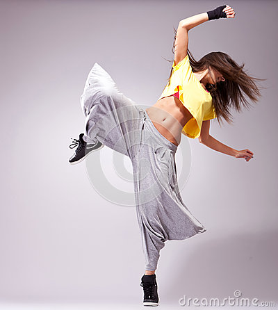 Young woman dancer posing