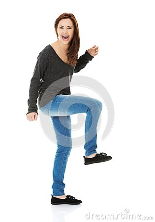 Free Young Woman Dancing And Laughing Stock Image - 45807481