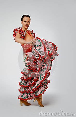 Young woman dancing flamenco with castanets