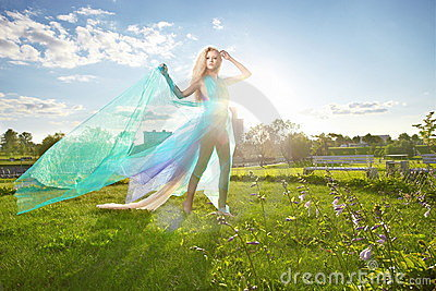 Young woman dancing in the morning bright spring