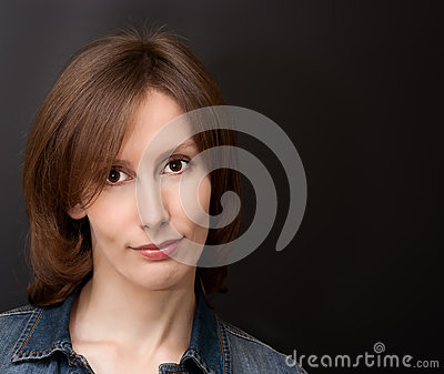 Young woman dark background