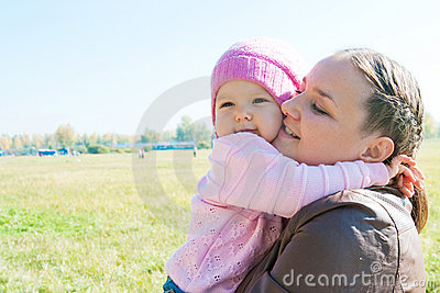 The young woman with the daughter on walk