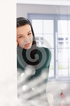Young woman daydreaming by window
