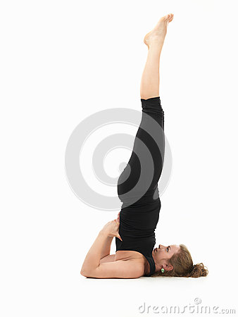 young woman demonstrating difficult yoga pose royalty free