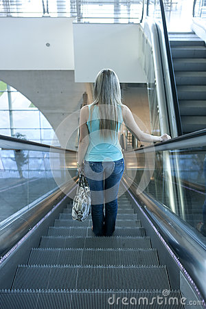 Young woman descending an escalator