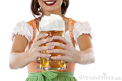 Young woman in dirndl holds Oktoberfest beer stein