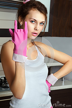 Young woman with dish gloves