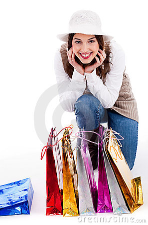 Young woman display all her shopping bags