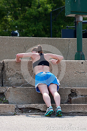 Young Woman Does Pushups Against Concrete Steps Editorial Stock Photo