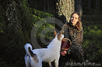 Young Woman with dog Picking Cowberrys.