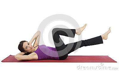 Young woman doing crunch during workout Stock Photo