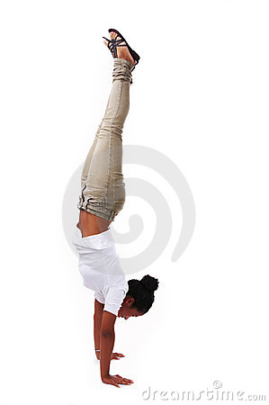 Young woman doing handstand