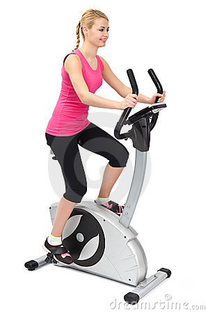Young woman doing indoor biking exercise