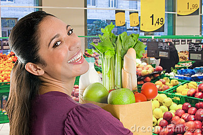 Young woman doing shopping in a supermarket
