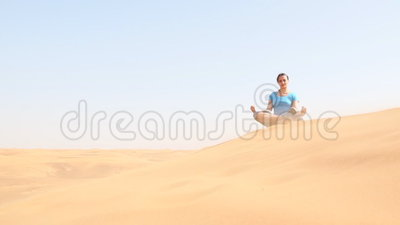 Young woman doing yoga in the desert. Footage taken in the UAE stock video footage